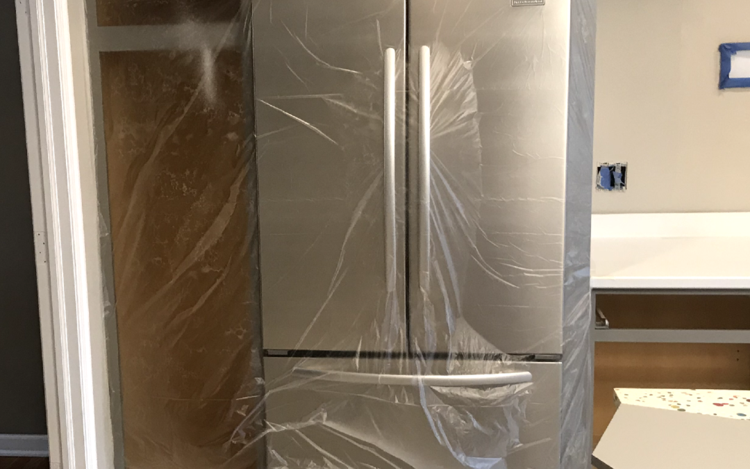 SHOULD I PAINT BEHIND MY FRIDGE AND LIGHT SWITCHES?